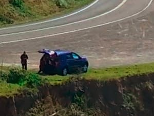 SUV Off Cliff