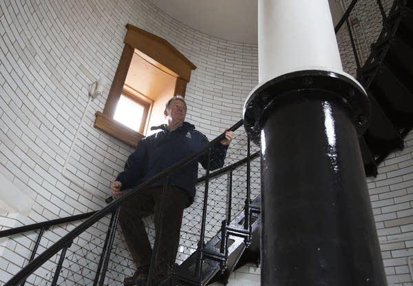 Lee Radzak climbs down spiral steps inside Split Rock Lighthouse.