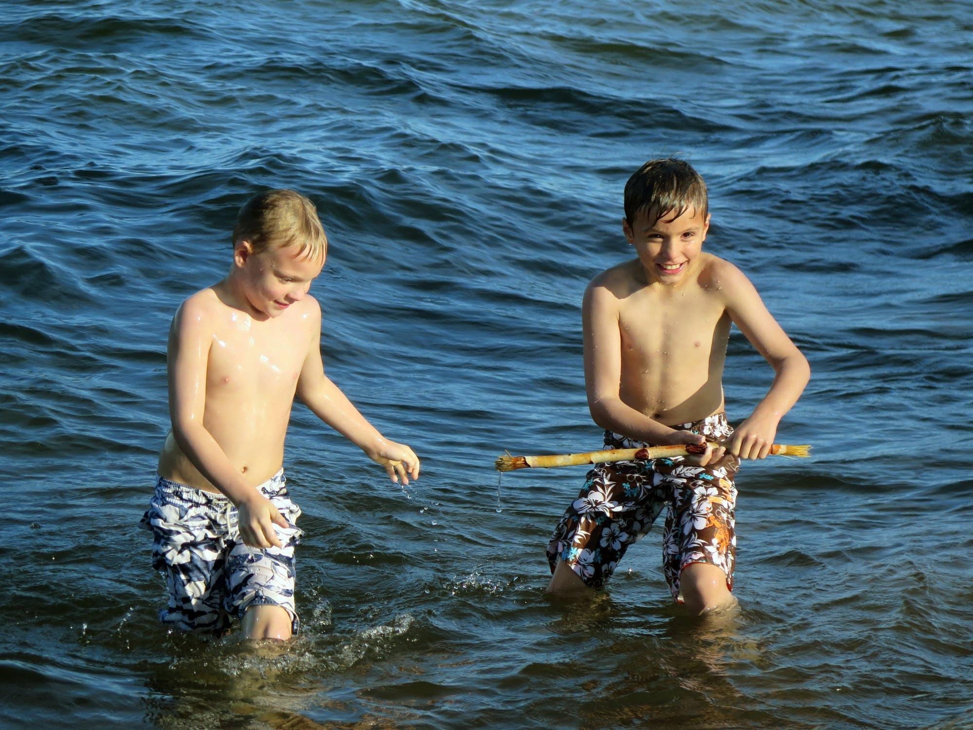 Landon and Gage Jones play in Lake Superior.