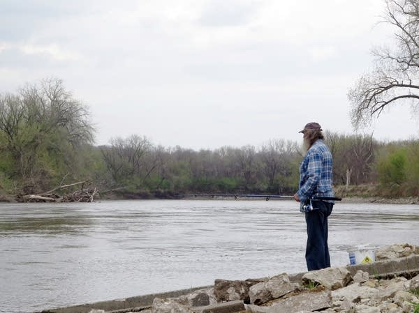 Steve Fox of Des Moines fishes in the Raccoon River near Des Moines.