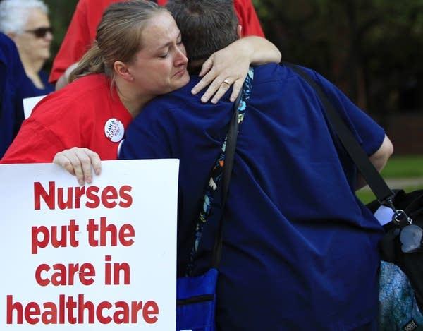 Striking nurses greet those coming off shifts.