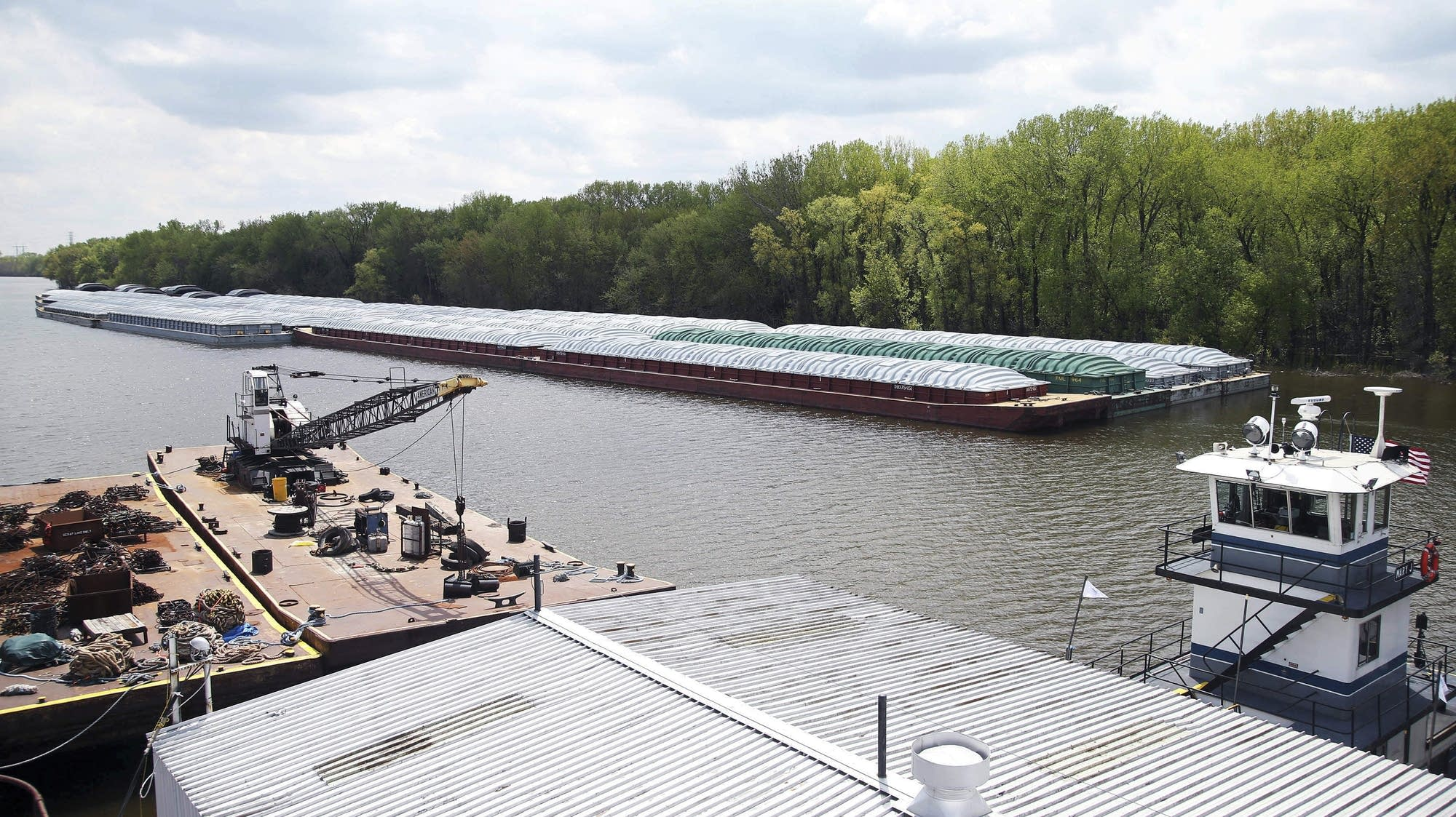 Barges await movement on the Mississippi River in St. Paul