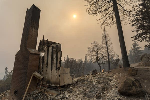 A home is destroyed after a wildfire.
