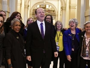 Colorado Gov.-elect Jared Polis jokes with state House and Senate members