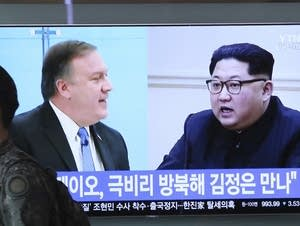 CIA Director Mike Pompeo and North Korean leader Kim Jong Un on screen.