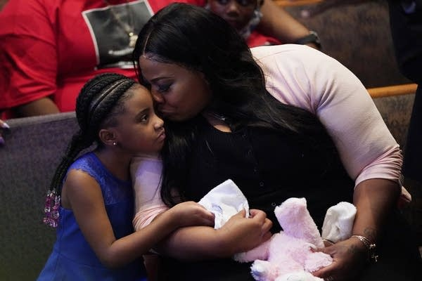Roxie Washington holds Gianna Floyd, the daughter of George Floyd.
