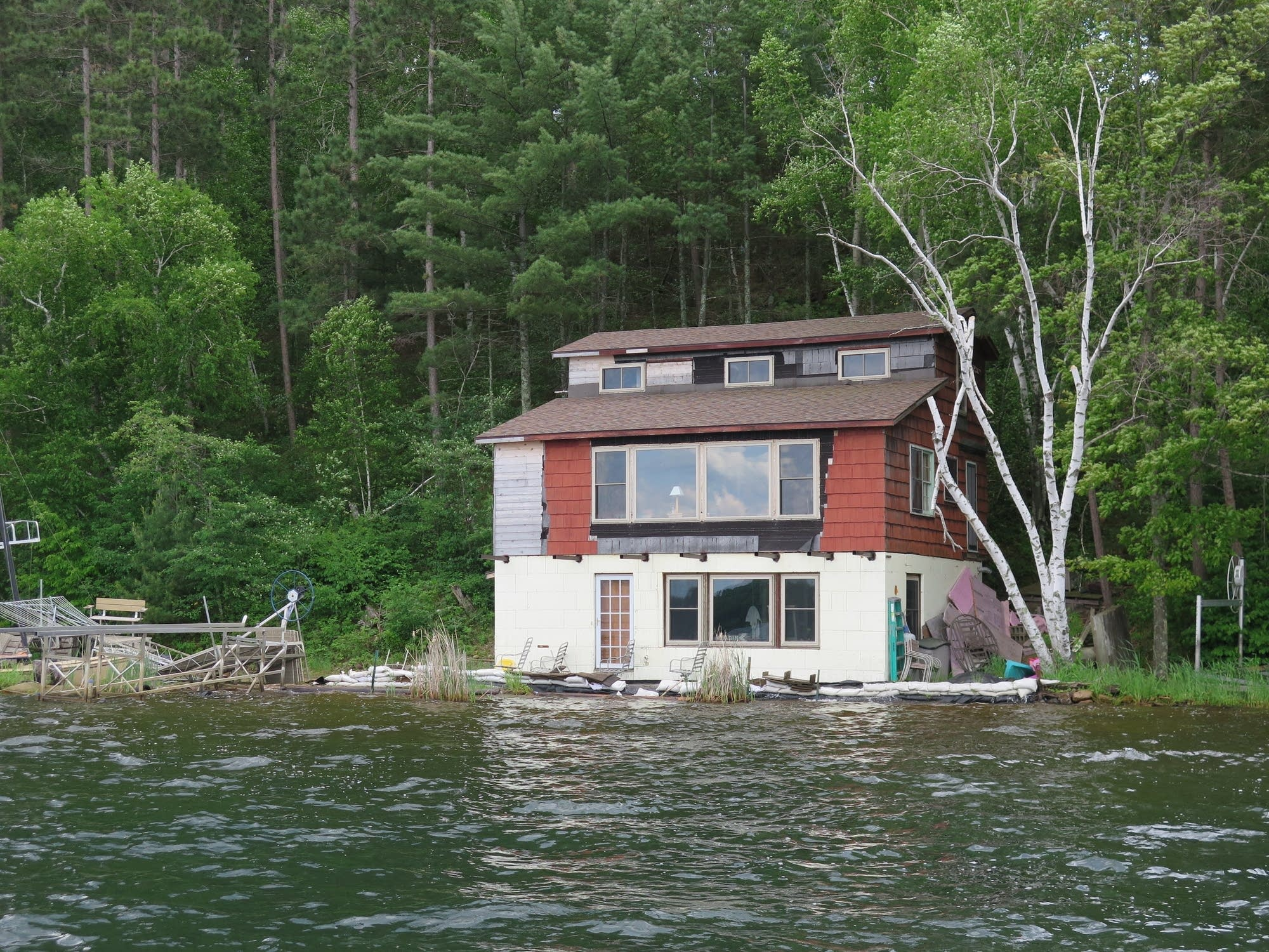 Homes and cabins on Lake Shamineau are threatened by rising lake waters