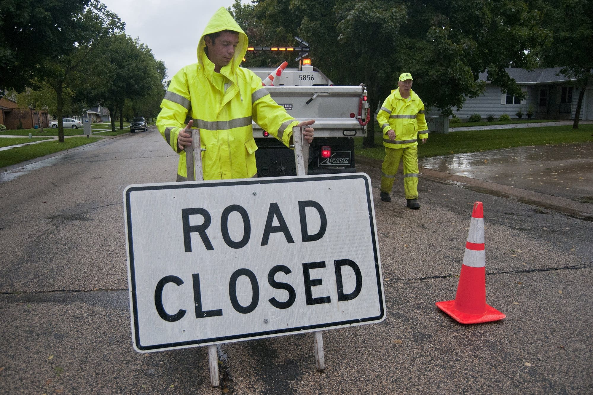 Mankato utilities workers remove road signs.