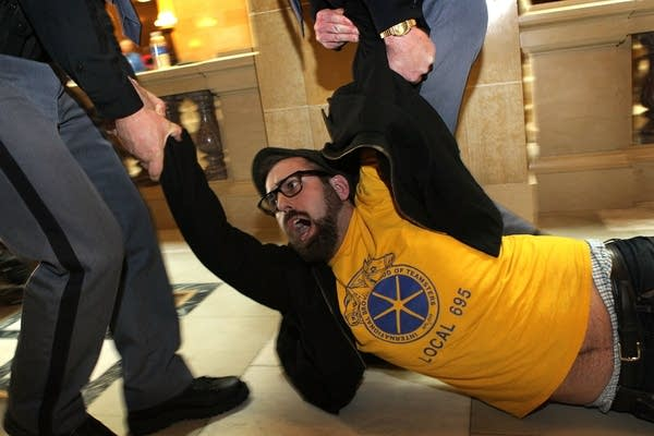 Protester dragged