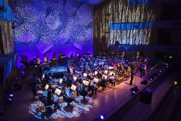 The lights of Orchestra Hall shine on the Minnesota Orchestra.