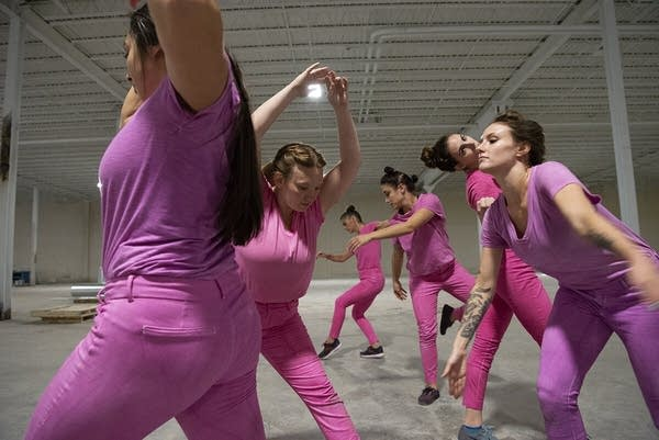 six women in pink clothing dancing