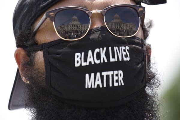 "Elijah Allen of St. Paul wears a mask with the words ""Black Lives Matter"""