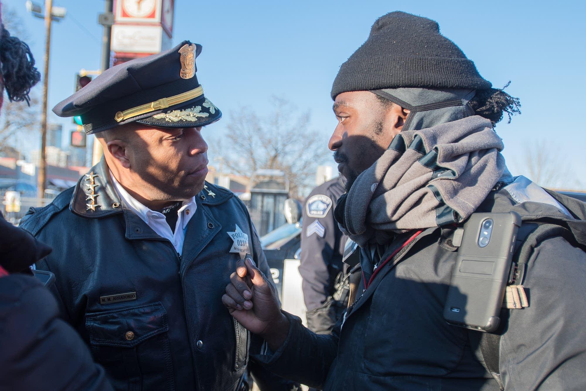 Minneapolis police chief Medaria Arradondo talks to Jeremy Little.