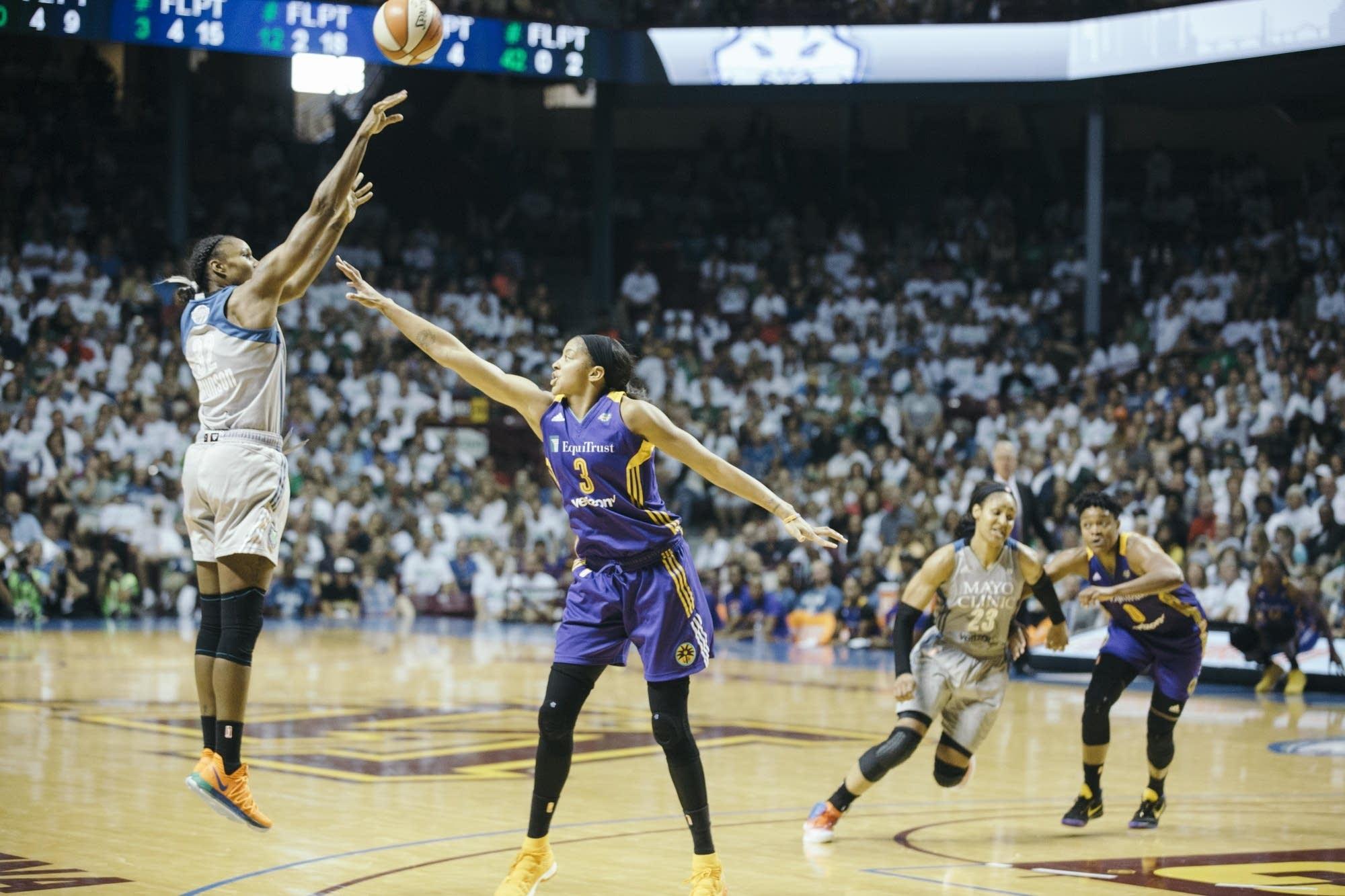Lynx forward Rebekkah Brunson shoots a 3-pointer.