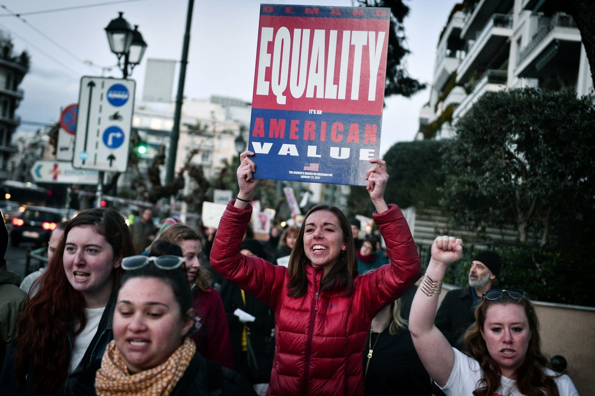 Athens, Greece: Demonstrators hold placards and chant slogans.