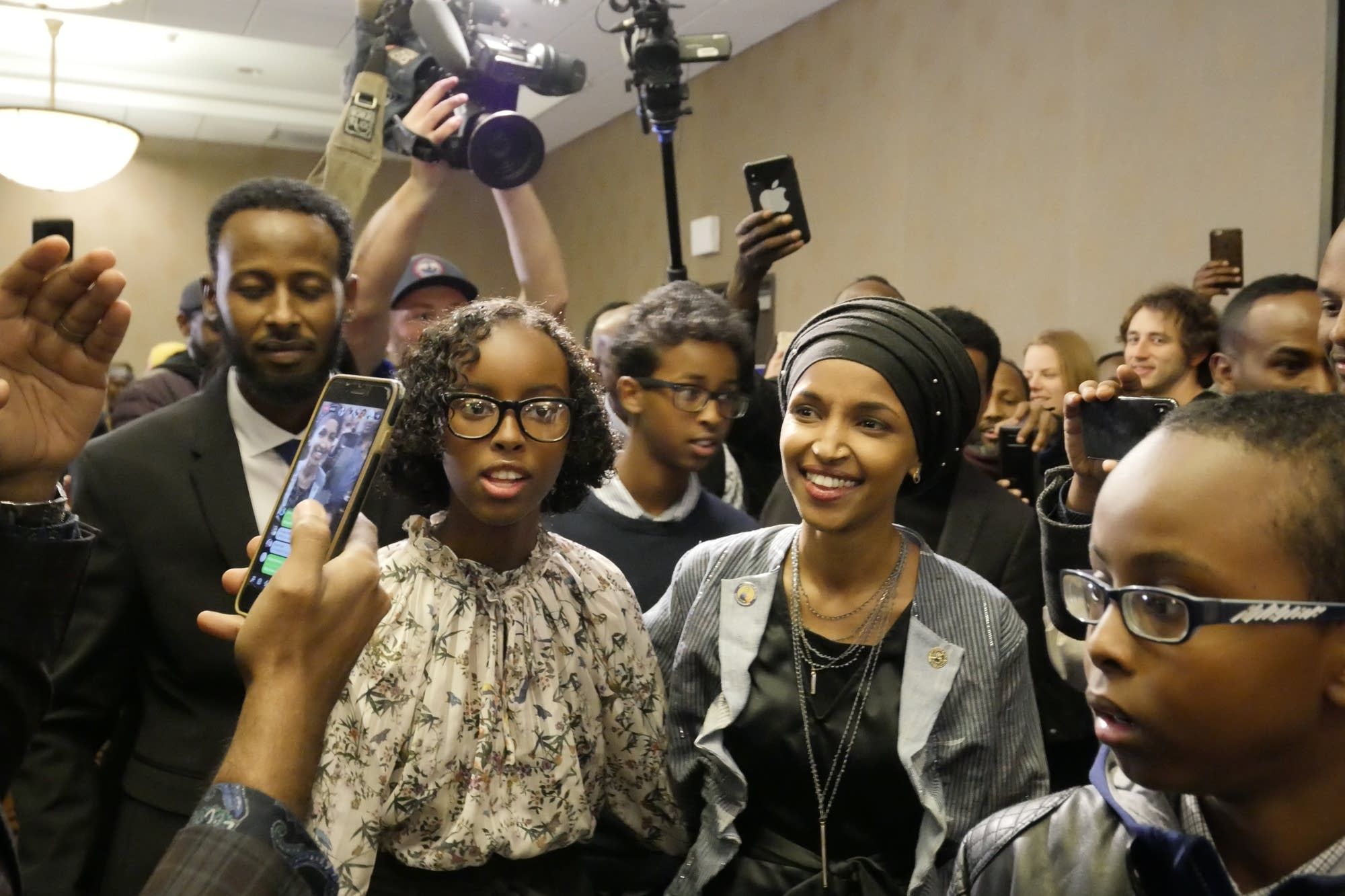 Ilhan Omar and her family enter her victory party.