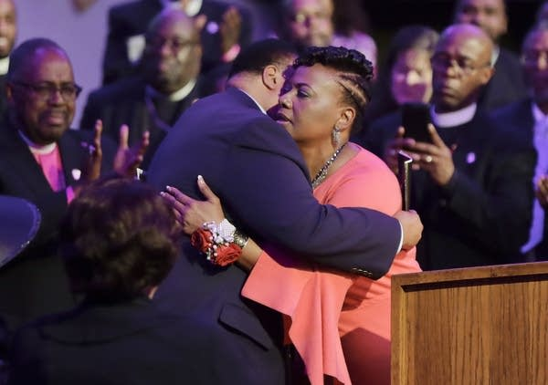Martin Luther King III hugs his sister, the Rev. Bernice King.