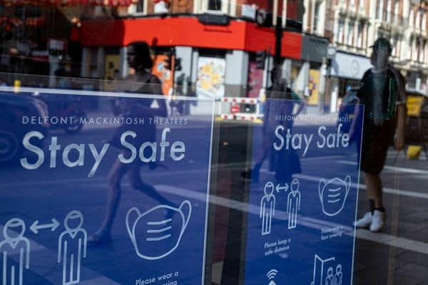 """Signs read """"stay safe"""" on a window."""