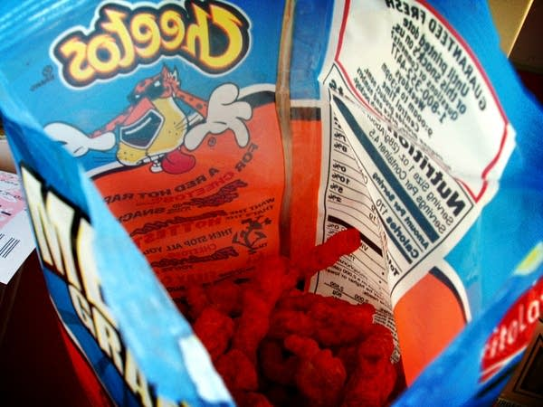 Photo looking down into an open bag od Hot Cheetos