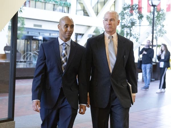 Former Minneapolis police officer Mohamed Noor with his attorney