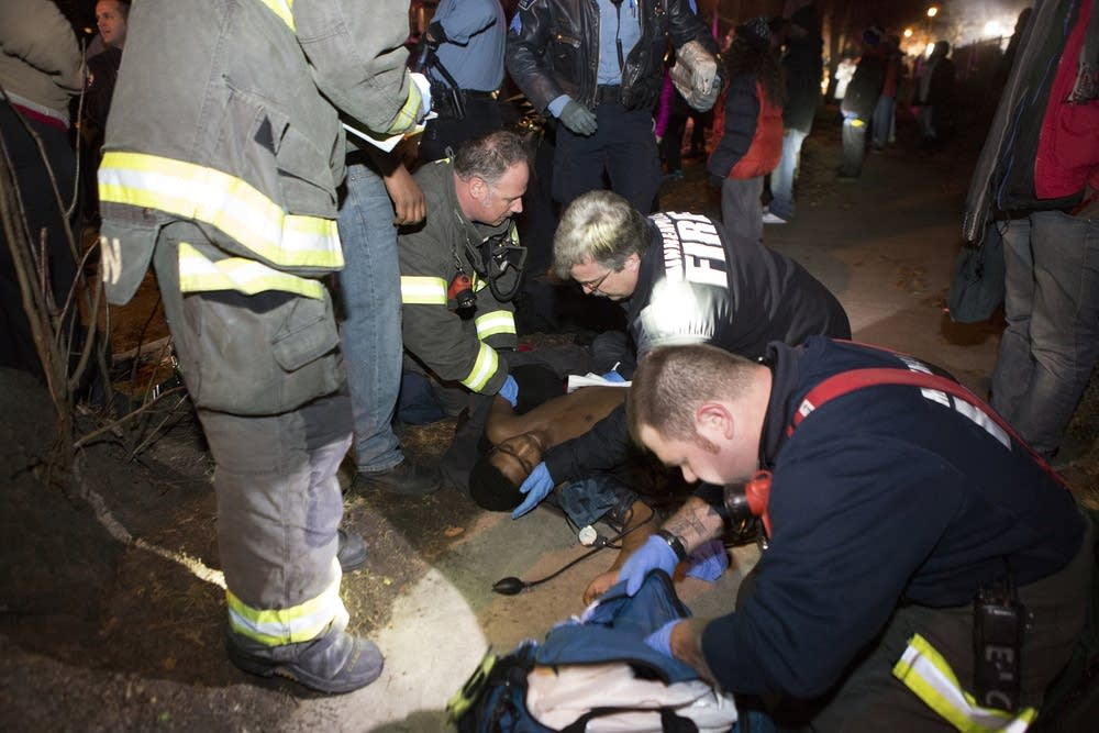 Paramedics tend to one of the shooting victims.