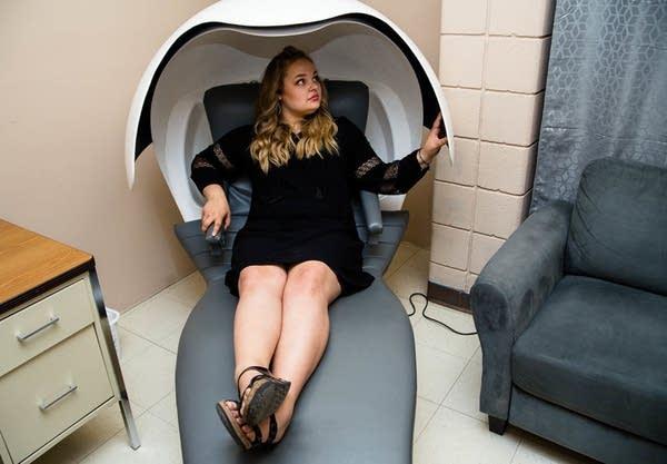 Hannah Vanderkooy demonstrates a napping pod