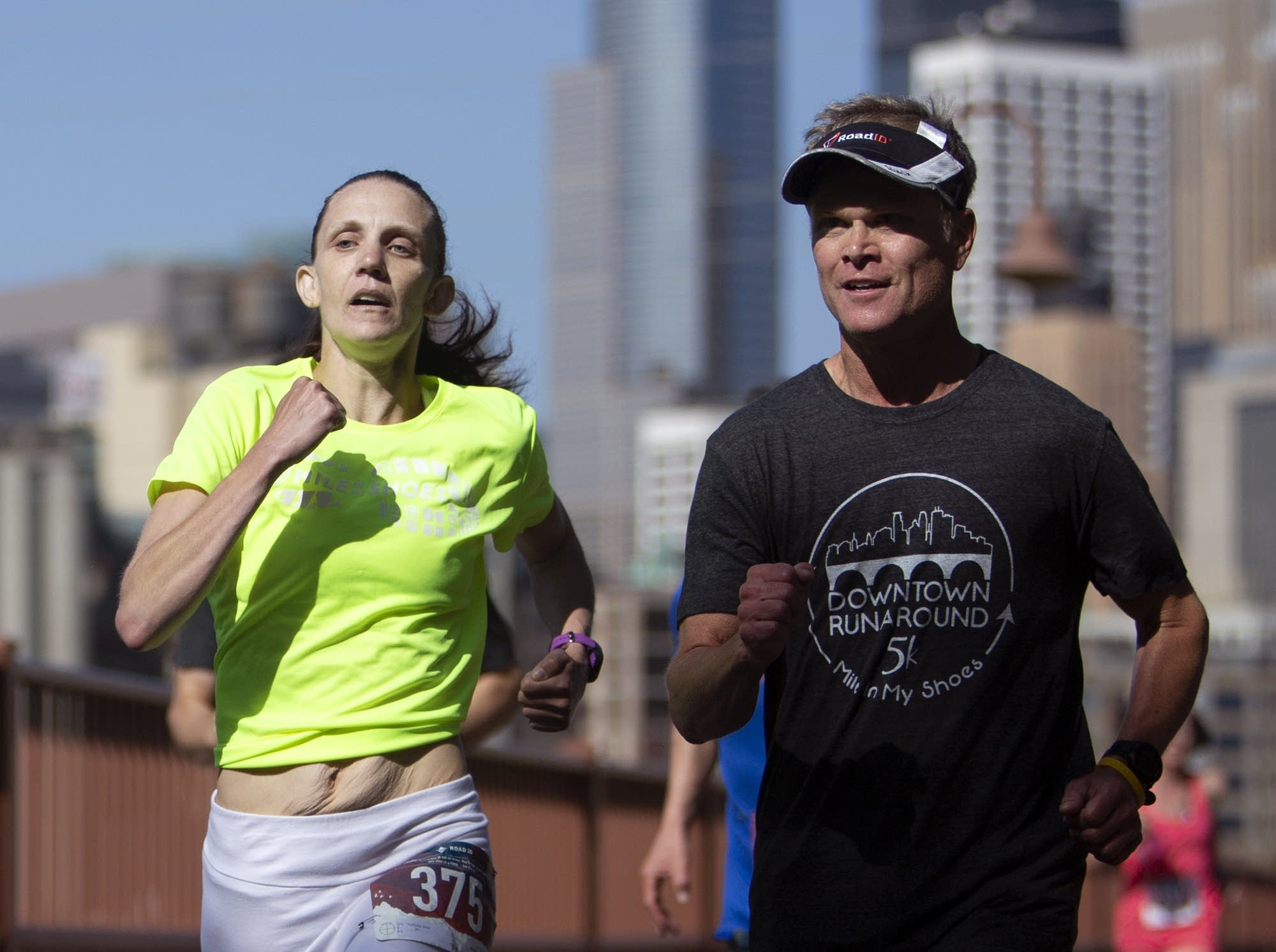 Amy Vorlicky and Steve English sprint to the finish line.