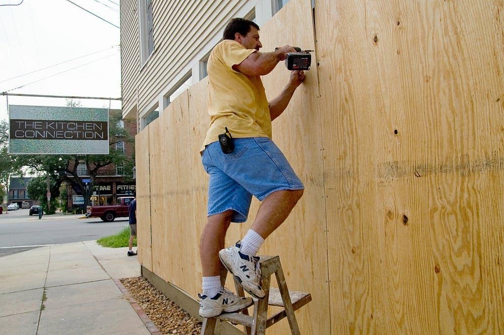 Tyler Malejko drills wood covers for windows