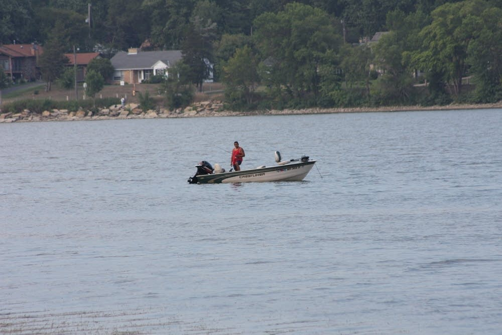 A man fishes in Lake Phalen