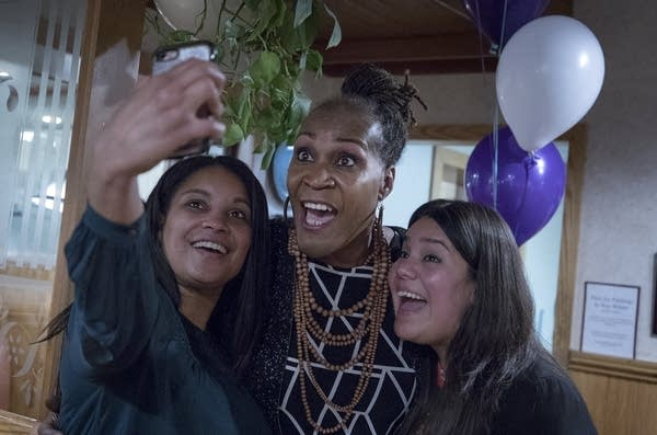 Deebaa Sirdar and Sara Lopez take a selfie with Andrea Jenkins