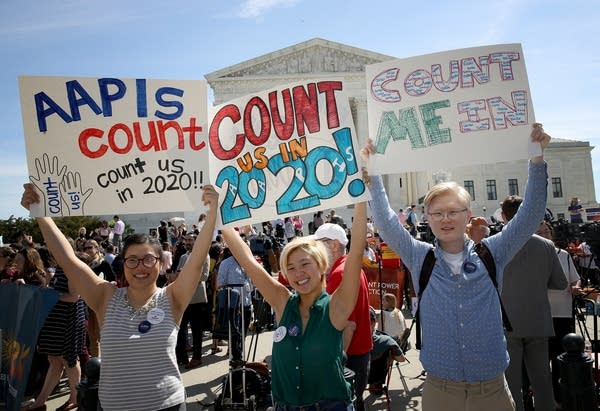 Protesters gather outside the U.S. Supreme Court