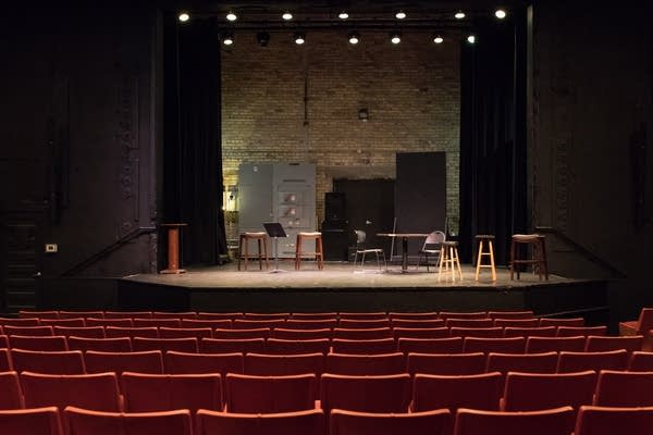 Miscellaneous chairs wait onstage in anticipation of an open house.