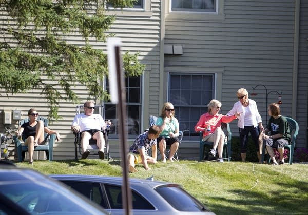 Neighbors set up chairs to watch the protest.