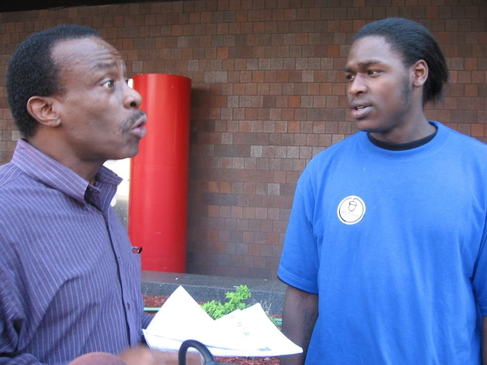Tyrone Spann talks to voter Steve Burston