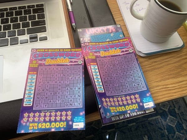 "A pair of ""Crossword Doubler"" Lotto Tickets on Luke's desk"