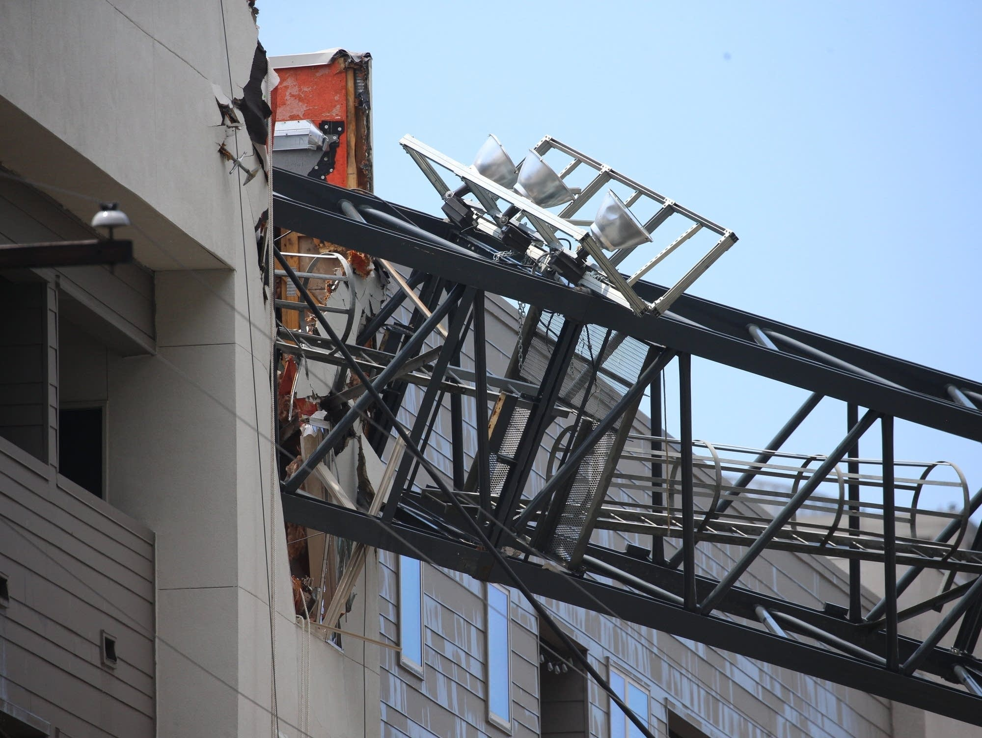 Part of a crane is seen after it collapsed in Dallas