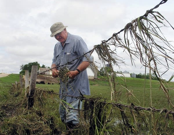 Dennis Tweet fixes fences damaged by storms.