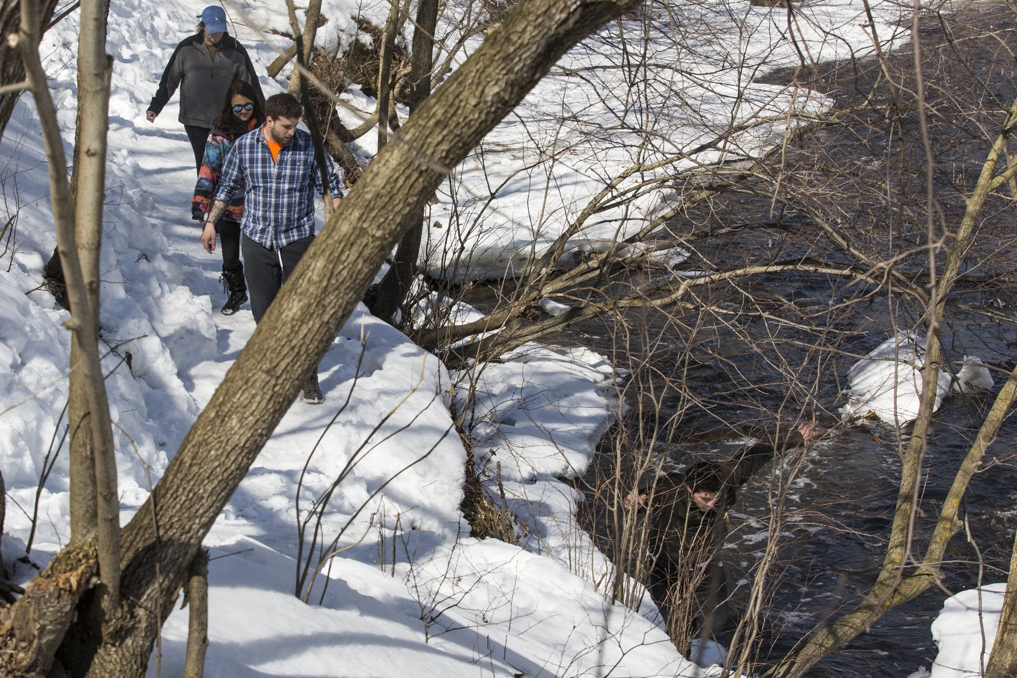 A group of hikers amble along the trail from Minnehaha Falls