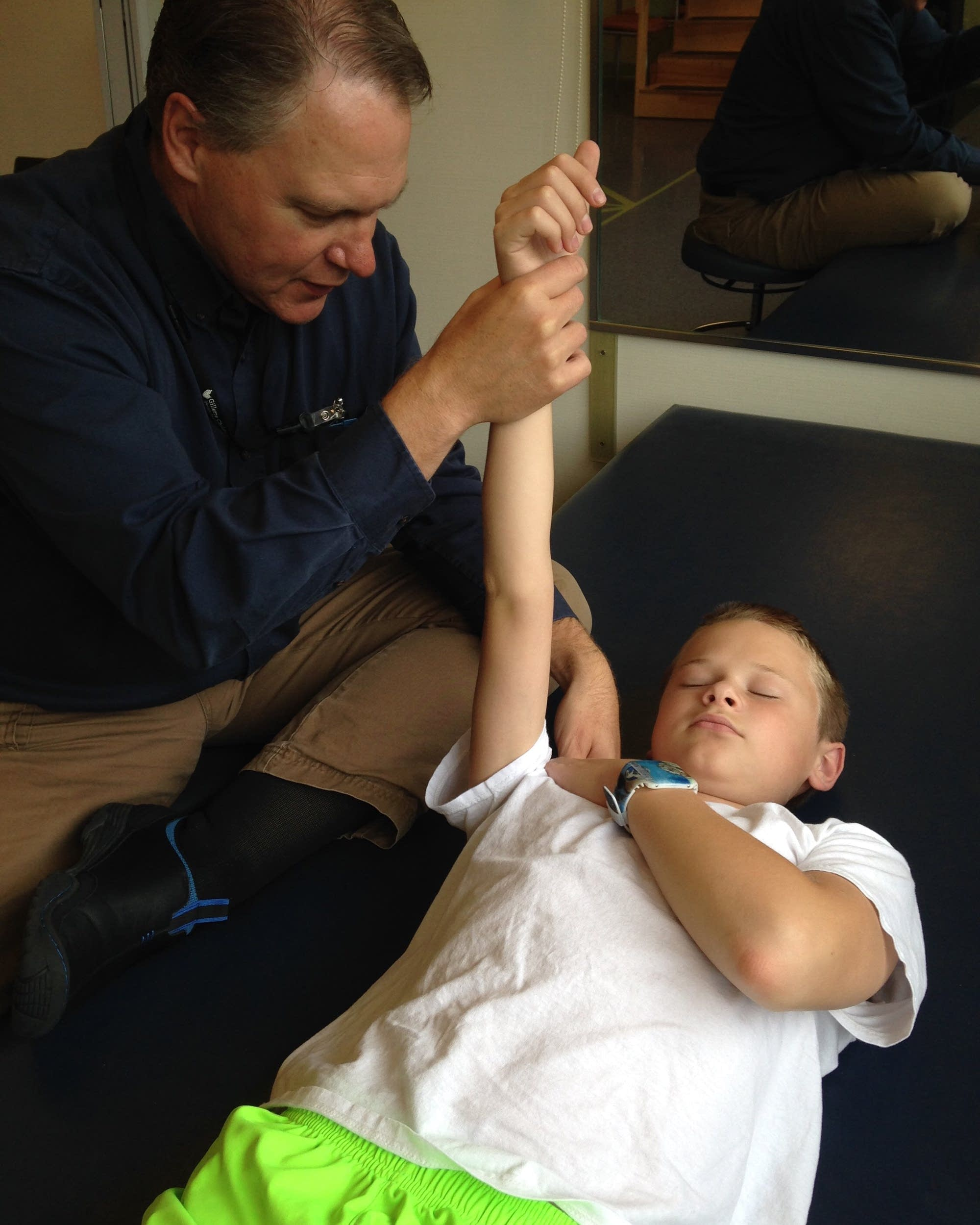 Craig Swanson undergoes physical therapy in October 2014.