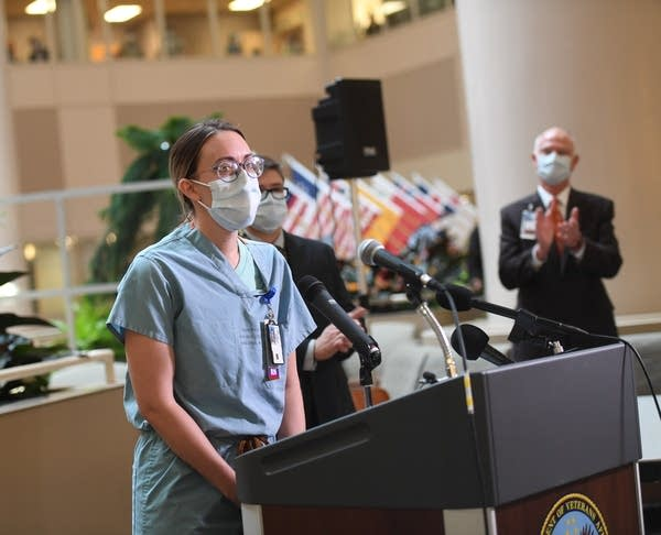 Thera Witte, RN, speaks during a press conference.
