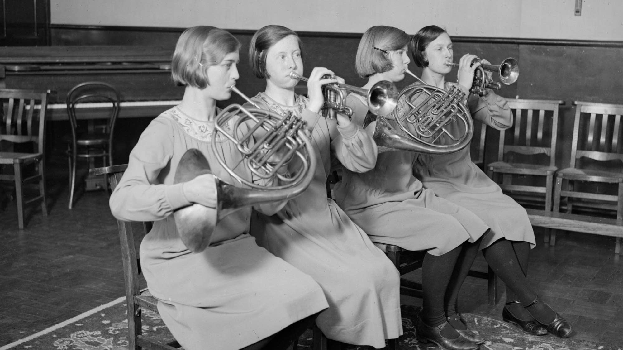 Horn and trumpet players perform at England's Queenswood College in 1932.