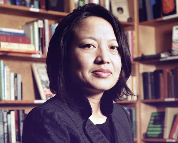 PaDer Vang now studies Hmong teen marriages.