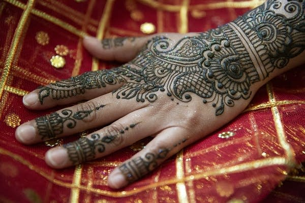 Henna paste dries on Fahmidha Ameen's hand.