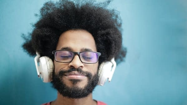 A man listening to music on headphones.