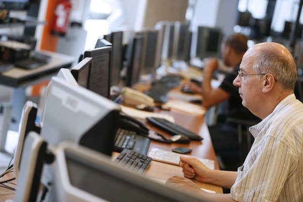 Employees work in a monitoring office at