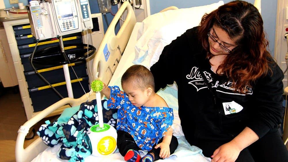 Miguel Espinoza, 2, and his mom, Kiras