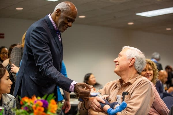 Retired Minn. Supreme Court Justice Alan Page greets his grand-nephew.