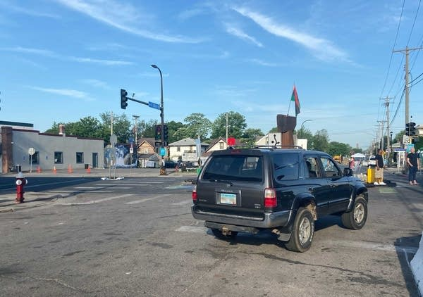 A car drives through an intersection.