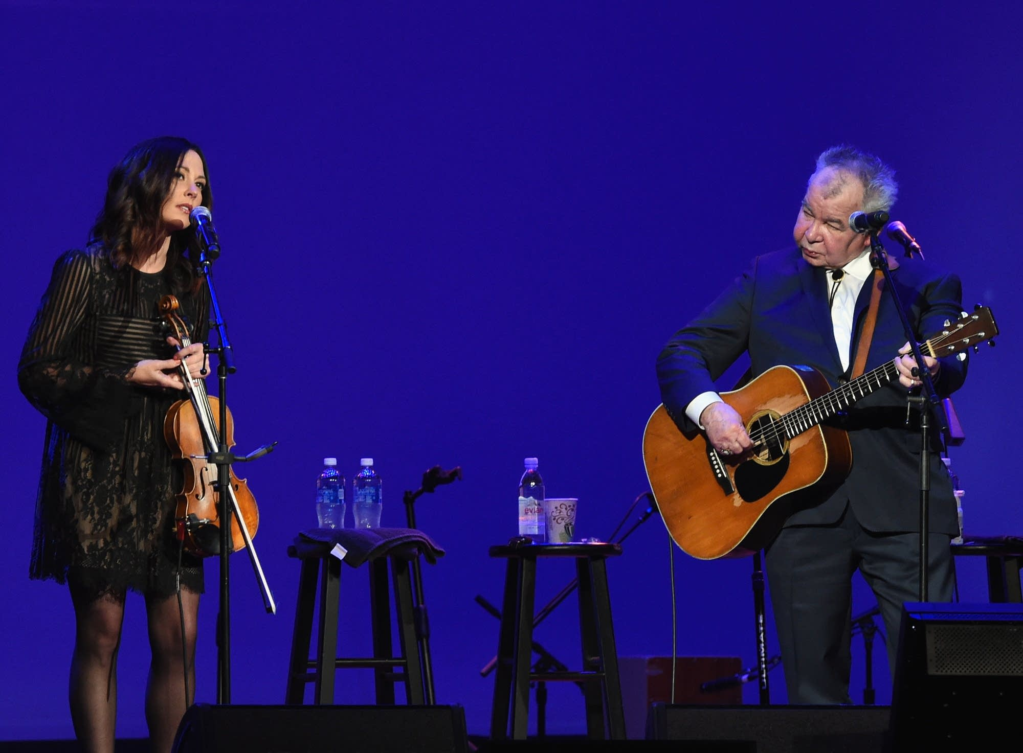 Amanda Shires and John Prine performing onstage in 2017