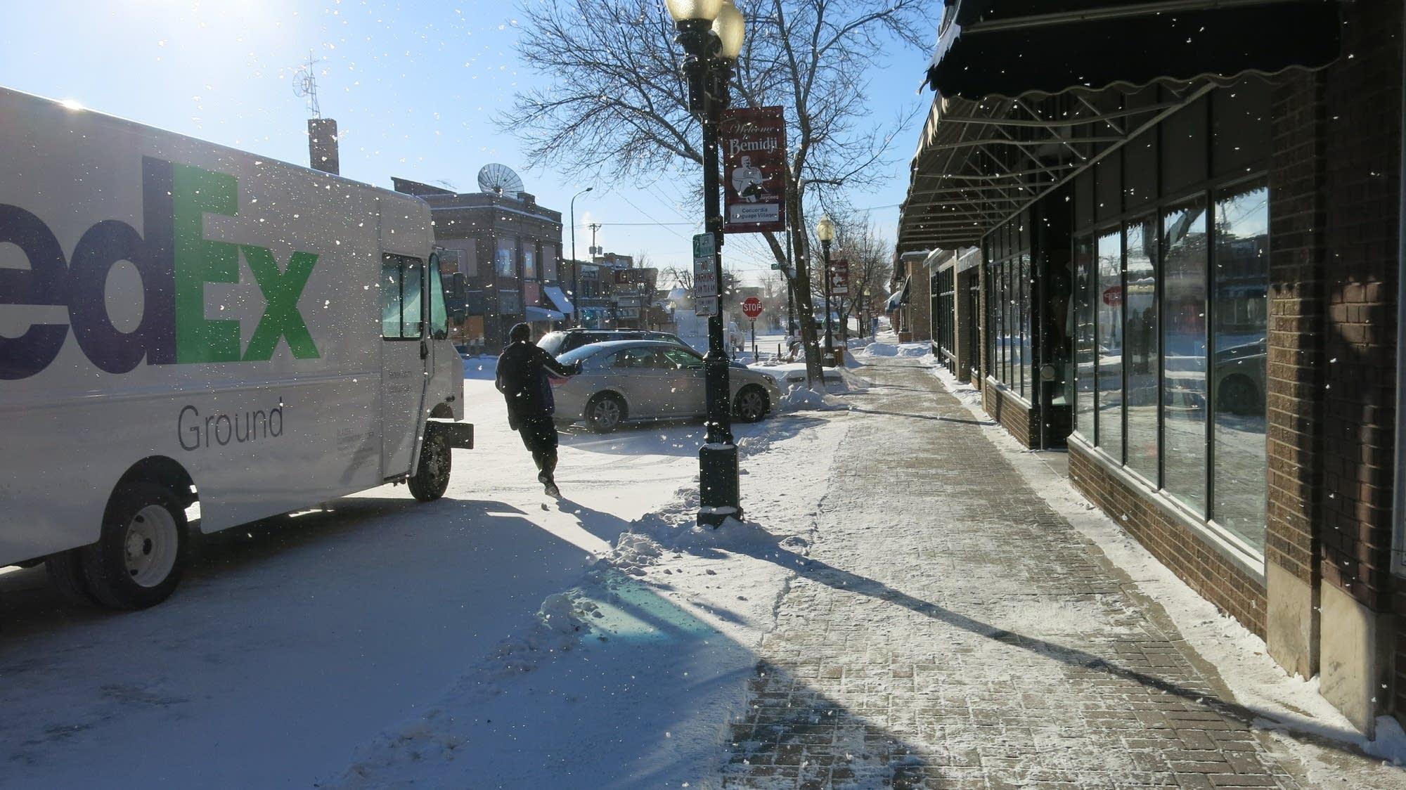 FedEx driver Dustin Fraley runs to keep warm.